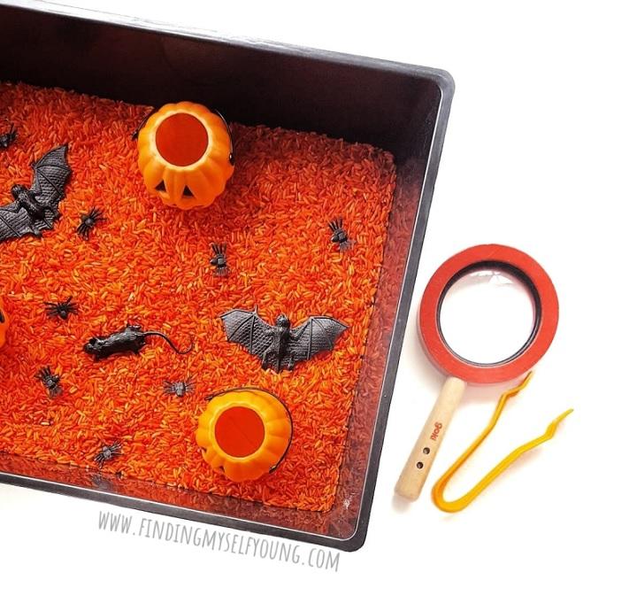 halloween sensory play tray with orange sensory rice