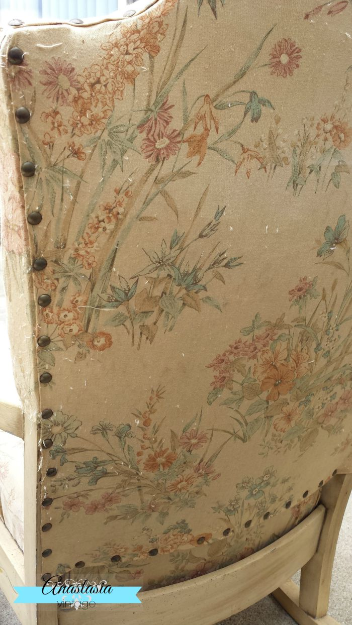 back of vintage rocking chair with floral upholstery and tacks