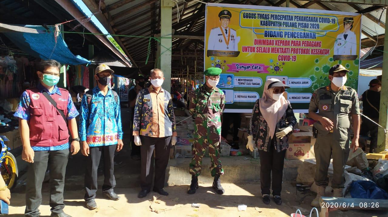 Cegah Penyebaran Covid-19, Tim Gugus Tugas Covid-19 Pulpis Gelar Sosialiasi Di Pasar Mingguan Tahai Jaya