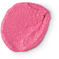 A oval shaped pink blob of body scrub on a bright background
