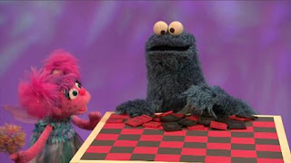 Abby Cadabby and Cookie Monster want to play checkers. Cookie Monster eats checkers. Sesame Street Episode 4416 Baby Bear's New Sitter season 44