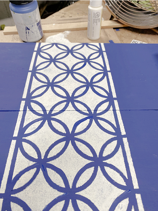 white and blue stenciled tray