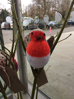 Photograph of a knitted robin
