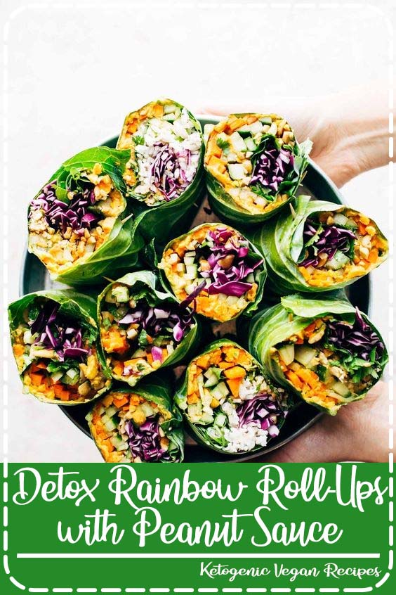 with curry hummus and veggies in a collard leaf Detox Rainbow Roll-Ups with Peanut Sauce