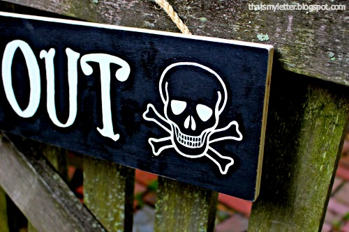 handpainted skull and crossbones sign