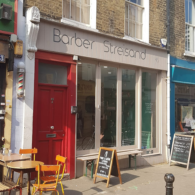 Barber Streisand in Exmouth Market, Clerkenwell, London. March 2019.