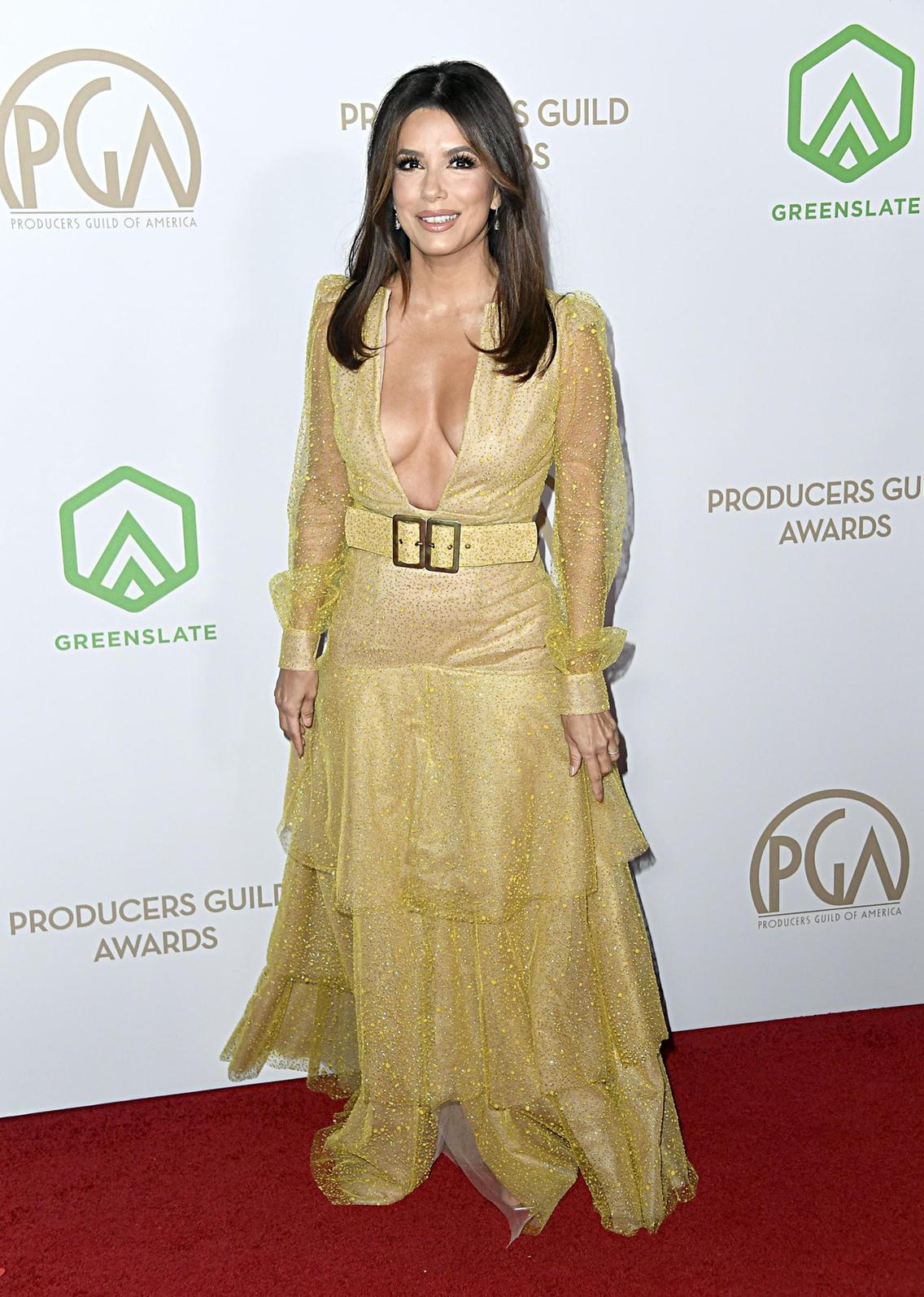 Eva Longoria dazzles in plunging gold gown at the 31st Annual Producers Guild Awards