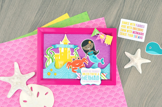 How to Create a Mermaid Frame with Jen Gallacher. Supply lists and links included. #papercraft #mermaidcraft