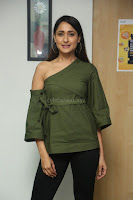 Pragya Jaiswal in a single Sleeves Off Shoulder Green Top Black Leggings promoting JJN Movie at Radio City 10.08.2017 057.JPG