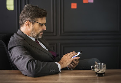men with coffee browse smartphone