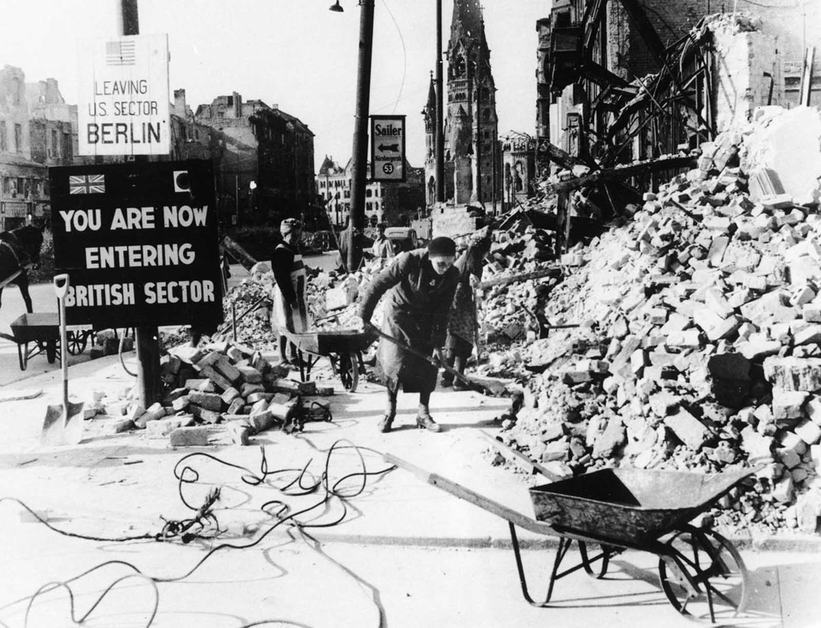 This 1945 photo shows German women clearing up the debris on Berlin's Tauentzienstrasse, with the ruins of the Kaiser Wilhelm Church in the background. The absence of able bodied men meant that the responsibility for clearing the wreckage fell mainly to civilian women, which were called