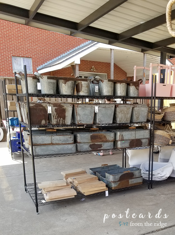 store shelves full of metal garden containers