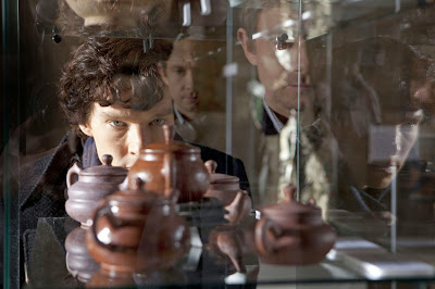 Benedict Cumberbatch as Sherlock Holmes studying Chinese Ming Pottery in BBC Sherlock Season 1 Episode 2 The Blind Banker