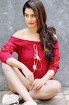 Payal Rajput hot in short dress legs flaunting photos
