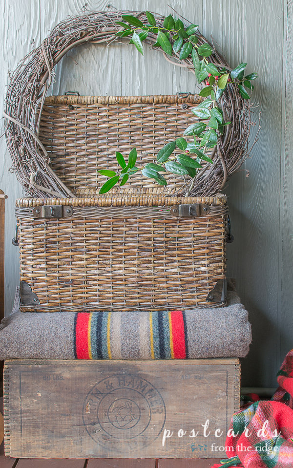 grapevine wreath in woven basket with striped pendleton blanket