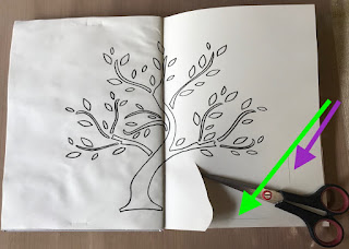 image tree outline in art journal with scissors and pencil marks and arrows