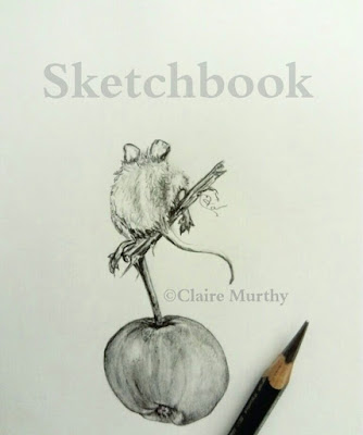graphite sketch of a mouse and apple