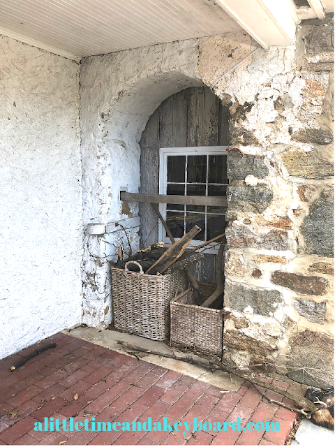 Stone, baskets and a wood frame are charming elements of Baldwin's Book Barn's 1822 milk barn.