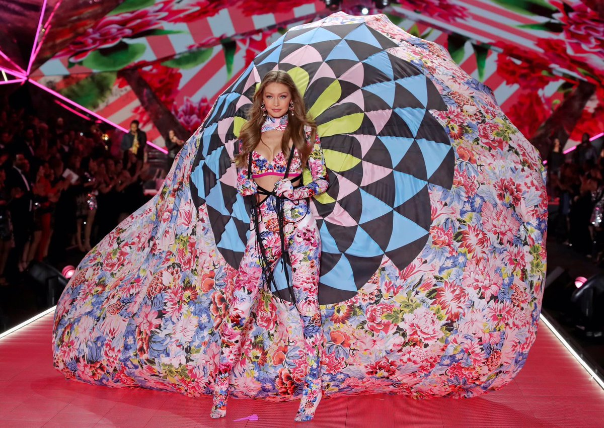 Gigi Hadid is pretty as a peacock in eye-catching parachute outfit as she returns to the Victoria's Secret Fashion Show catwalk