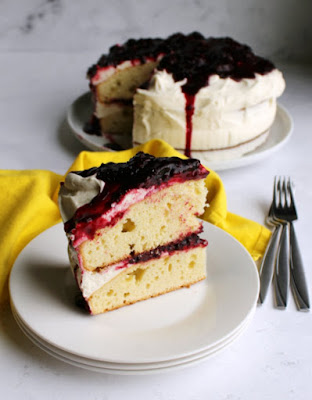 slice of blackberry shortcake cake served on plate with remaining cake in background