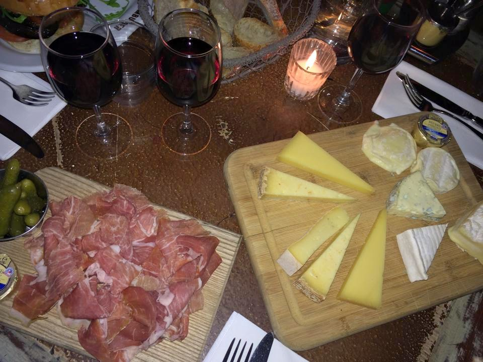 cheese board with charcuterie and red wine