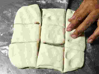 Cutted small square shape dough part for amritsari kulcha