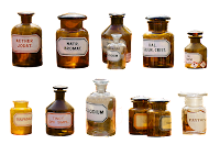 two rows or vintage glass bottles with chemical names