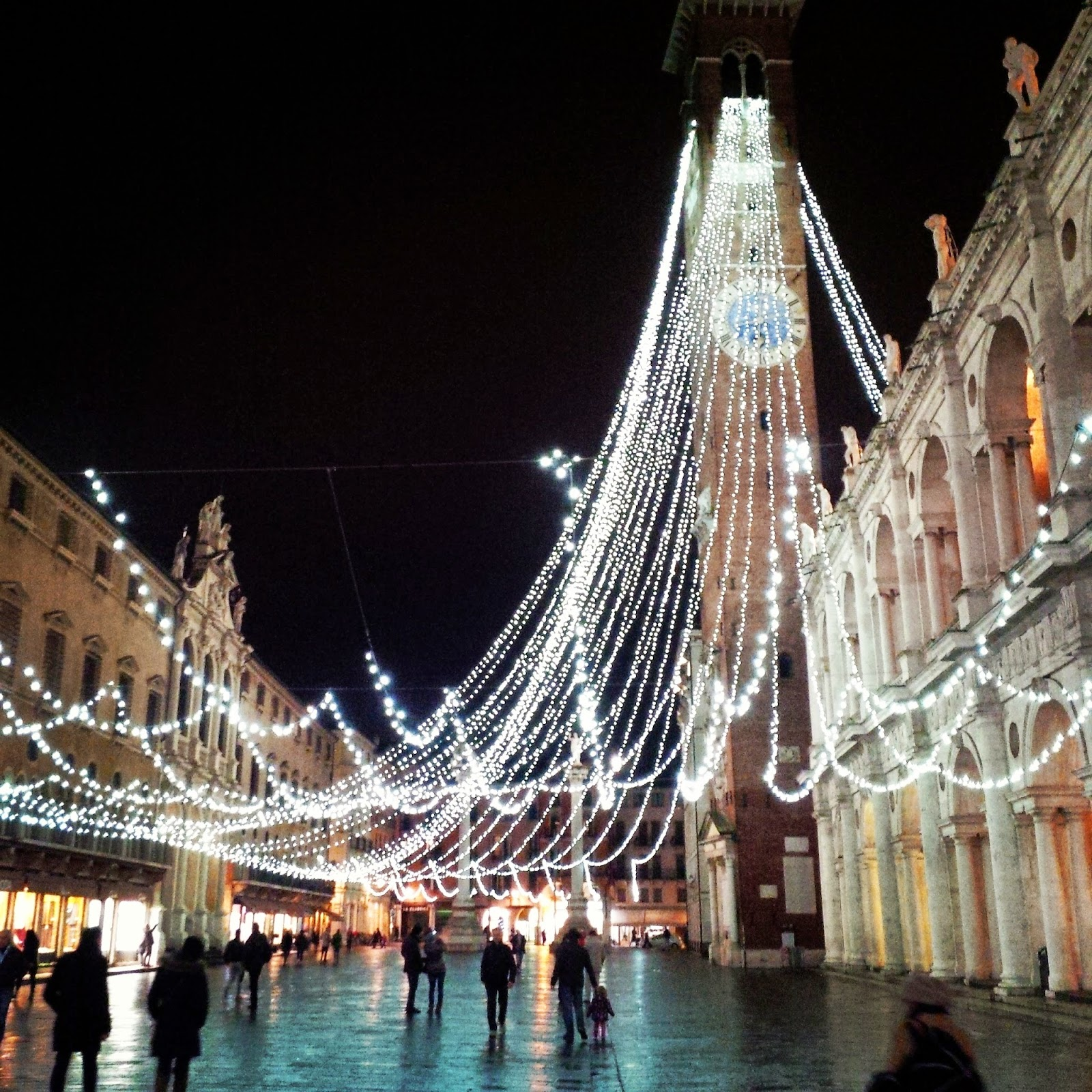 Christmas lights draped from the clocktower of Palladio's Basilica in Vicenza