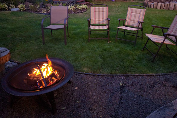 Fire pit in landscaped backyard