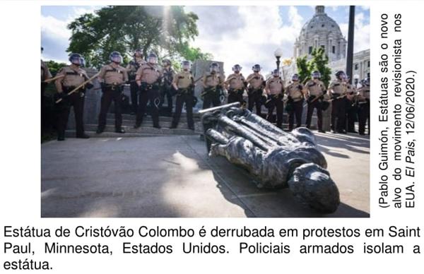 Estátua de Cristóvão Colombo é derrubada em protestos em Saint Paul, Minnesota, Estados Unidos. Policiais armados isolam a estátua.