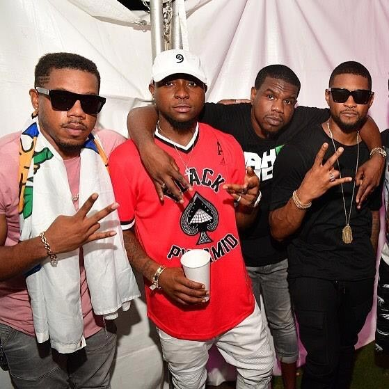 Davido pictured with Usher Raymond and friends