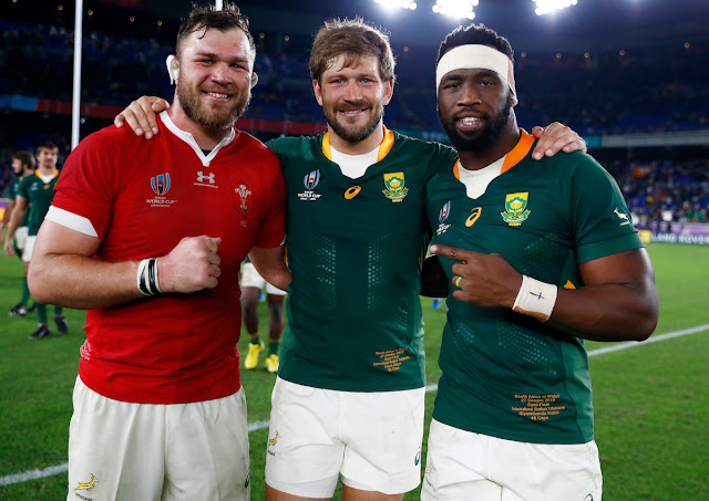 Duane Vermuelen, Frans Steyn and Siya Kolisi pose after South Africa beat Wales in the World Cup Semi-Final