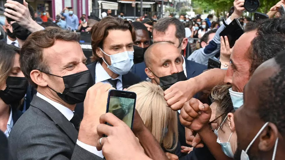 """Macron comments on the incident of his slap... and France's politicians are in solidarity with him French President Emmanuel Macron sought to play down the significance of Tuesday's slapping, saying that what happened was """"isolated actions of very violent people""""."""