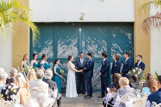 ceremony in front of Artisan Alley green doors