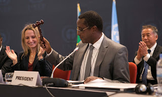 Dr Vincent Biruta, Rwandan government minister, hits a hammer to symbolise the adoption of the Kigali amendment on 15 October 2016. (Photograph Credit: Cyril Ndegeya/AFP/Getty Images) Click to Enlarge.