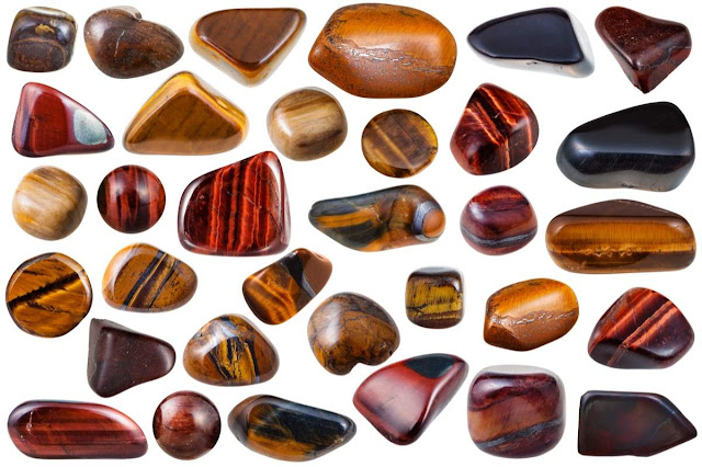 set of various tiger-eye natural mineral stones and gemstones (tigers eye, bull-eye, hawk-eye)