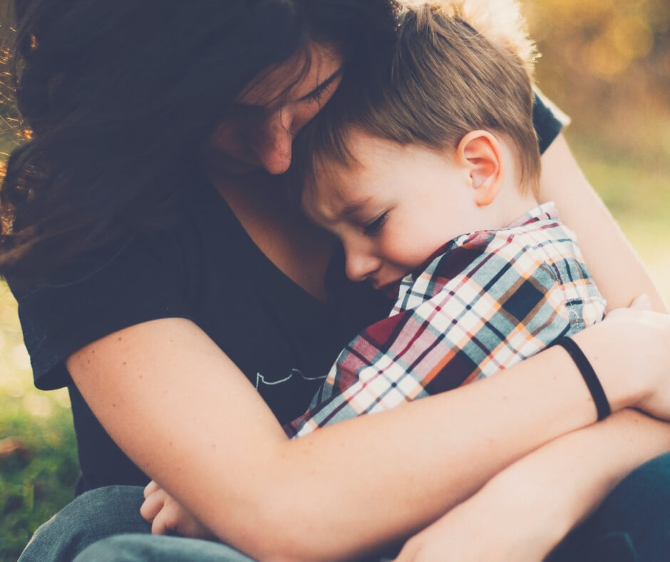 10 Things You'll Learn From Being A Parent | A mum hugs her son because he's ill.