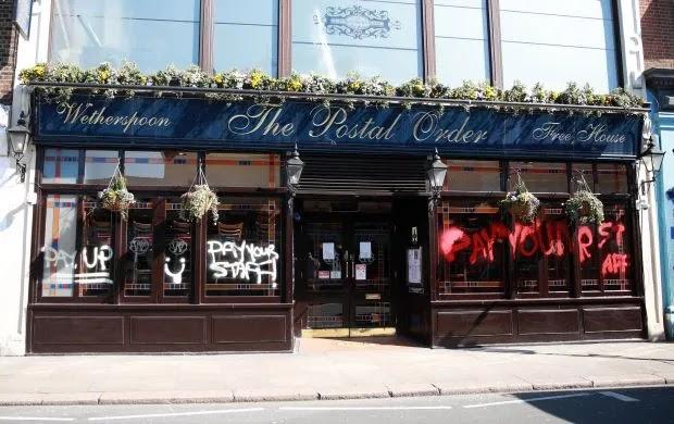 Graffiti sprayed onto Wetherspoons pub in London