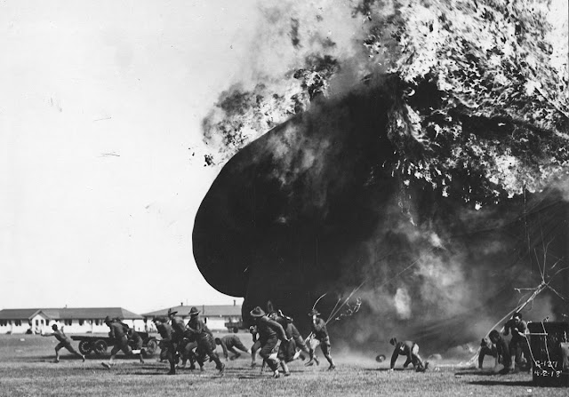 Men run from an exploding balloon at Post Field, Fort Sill, Oklahoma, on April 2, 1918.