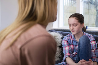 Concerned mother having conversation with stressed out girl
