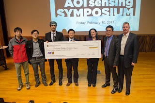 "Yangyang Chen, Jian Lin, Hussein Nassar and Guoliang Huang pose with Dean Elizabeth Loboa; AOI Founder, CEO and President Thompson Lin and AOI CFO Stephan Murry. Their winning project was titled ""Bimodal Waveguide Interferometric Sensors by Periodic Power-Wavelength Modulations of Laser Diodes."""