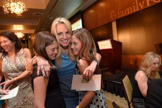 Polly Tsai hugging two girls