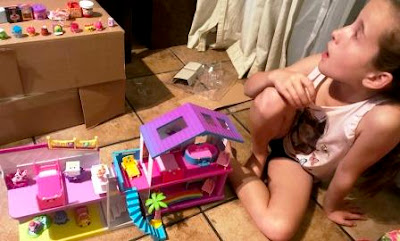 Girl playing with two Shopkins Happy Places and Small Mart mini packs