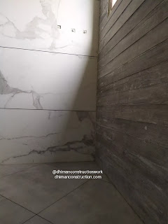 Small bathroom tile design with black and white tiles