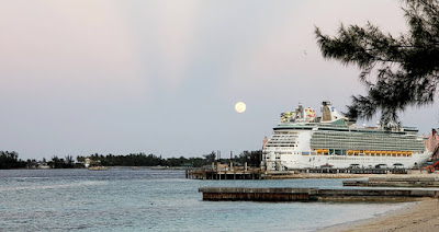 Full moon rising over cruise ships in harbour