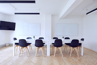 Blue Chairs around a White Table in a Coworking Space
