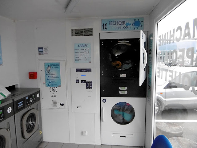 A supermarket laundromat.  Indre et Loire, France. Photographed by Susan Walter. Tour the Loire Valley with a classic car and a private guide.