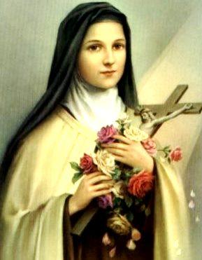 Imagen de Santa Teresa de Avila con flores y una cruz