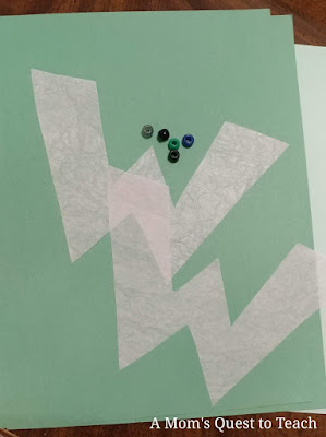 green construction paper, pink tissue paper letter Ws, beads