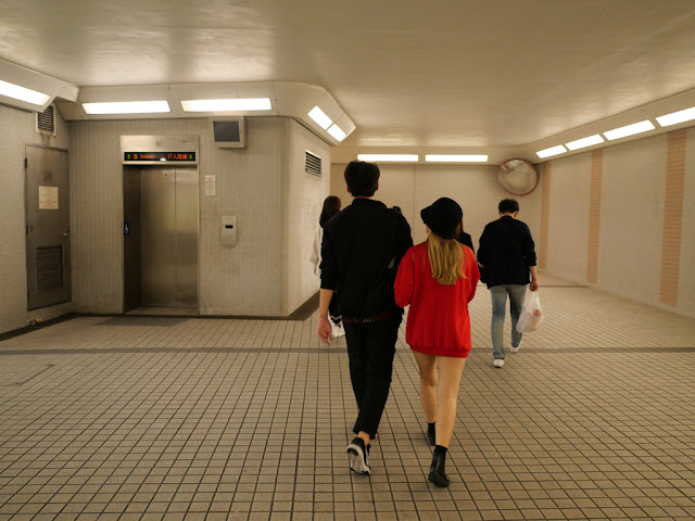 people walking in a pedestrian subway in Tsim Sha Tsui